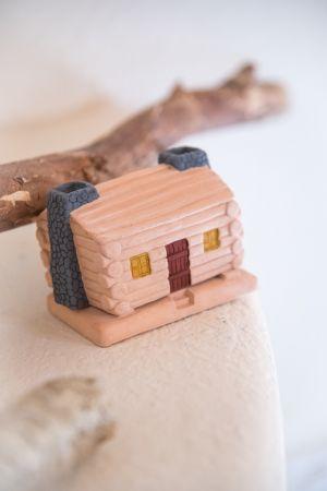 Log Cabin: with Pinon natural wood incense.